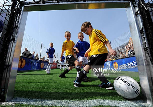 Children take part in a UEFA grassroots football match before the handover of the UEFA Europa League cup on April 13 2010 in Hamburg Germany