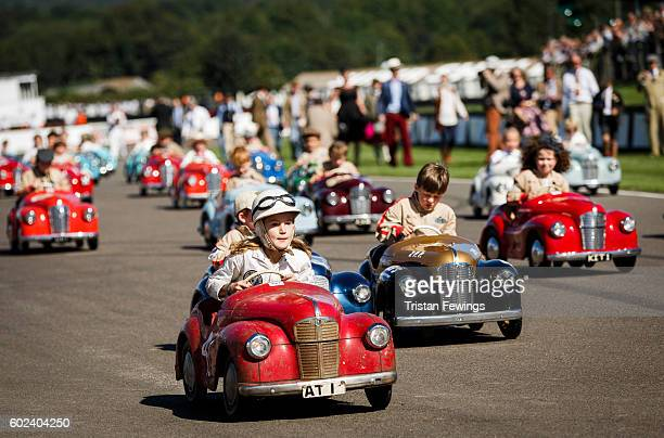 Children take part in a vintage pedal car race during the Goodwood Revival at Goodwood on September 11 2016 in Chichester England