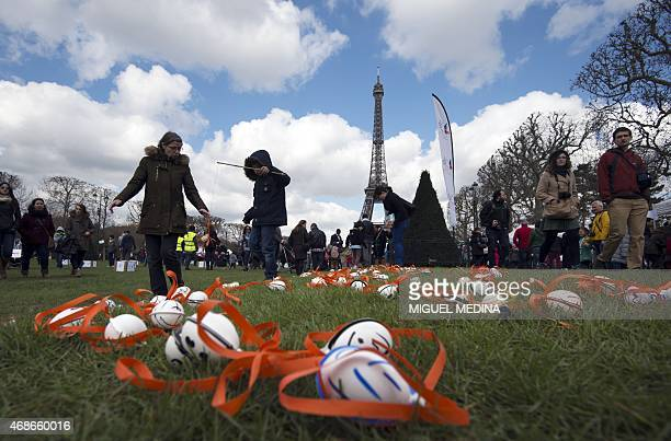 Children take part in an Easter egg hunt organized by the French nonprofit organization 'Secours populaire' at the Champ de Mars in front of the...