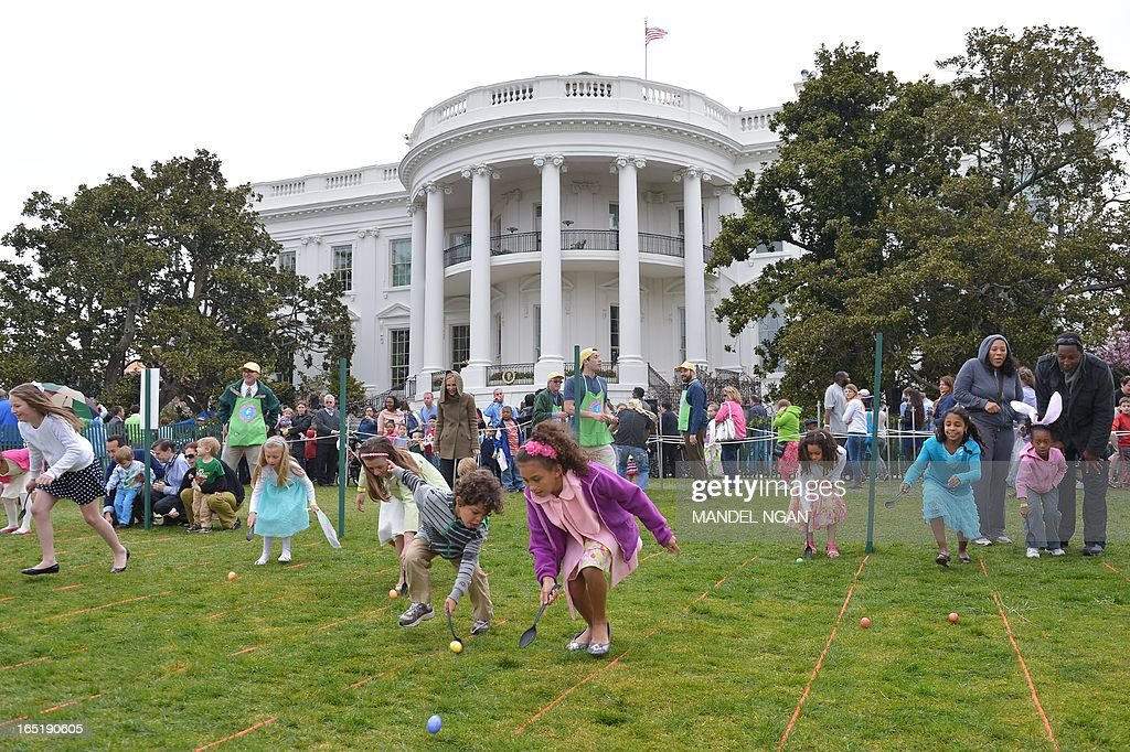 Children take part in the annual Easter Egg Roll on April 1, 2013 on the South Lawn of the White House in Washington, DC. AFP PHOTO/Mandel NGAN