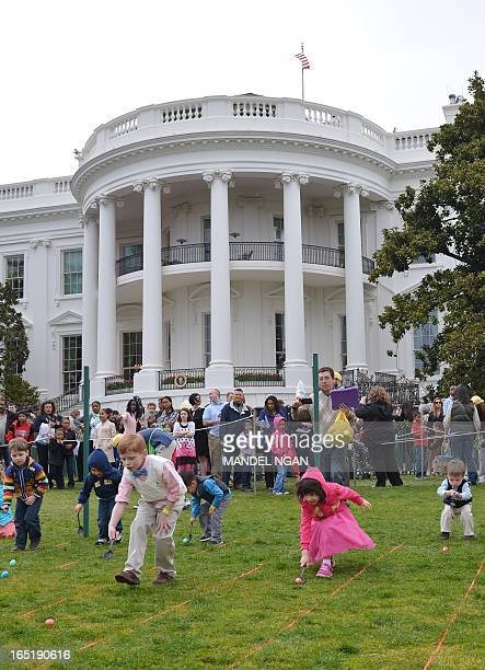Children take part in the annual Easter Egg Roll on April 1 2013 on the South Lawn of the White House in Washington DC AFP PHOTO/Mandel NGAN