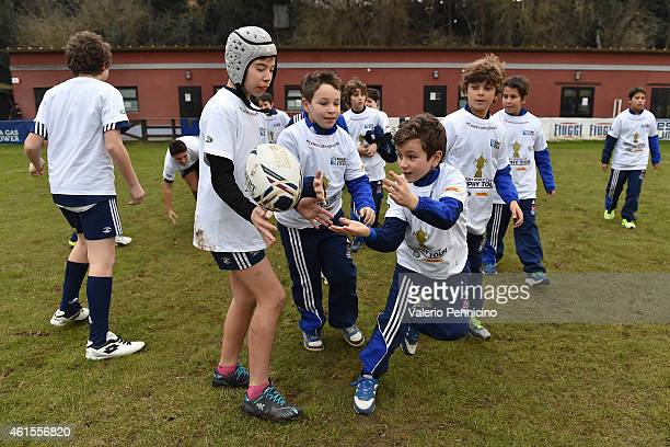 Children take part in the IRB Get Into Rugby tournament at Unione Rugby Capitolina Rome as part of the Rugby World Cup Trophy Tour delivered in...
