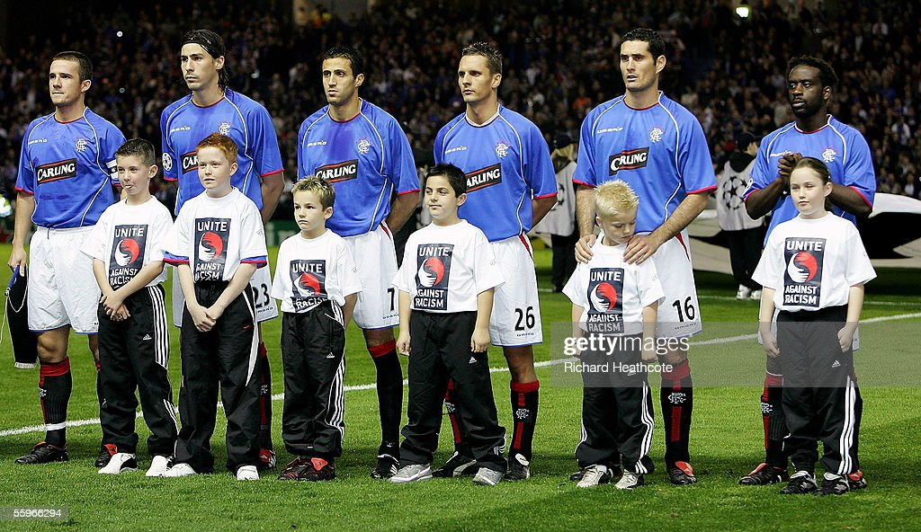 Children take part in the team line up wearing 'Unite Against Racism' t-shirts during the UEFA Champions League group H match between Glasgow Rangers and Artmedia Bratislava held at Ibrox October 19, 2005 in Glasgow, Scotland.