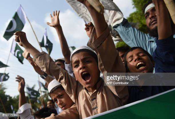 Children take part of JamaatudDawa protest rally to mark the first anniversary of the death of young rebel leader Burhan Wani who was killed by...