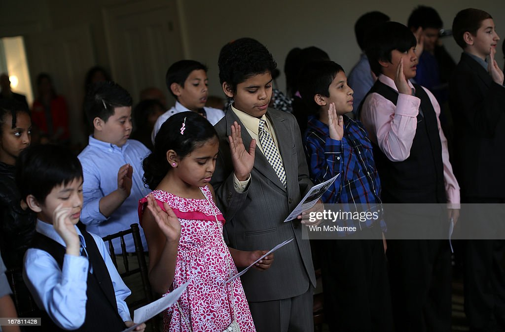 Children take the Oath of Allegiance during a naturalization ceremony in the Emancipation Room at President Abraham Lincoln's Cottage April 30, 2013 in Washington, DC. The special citizenship ceremony for twenty children was hosted by the U.S. Citizen and Immigration Services at the seasonal residence the Lincoln family used during the Civil War and the site where President Lincoln developed the Emancipation Proclamation.