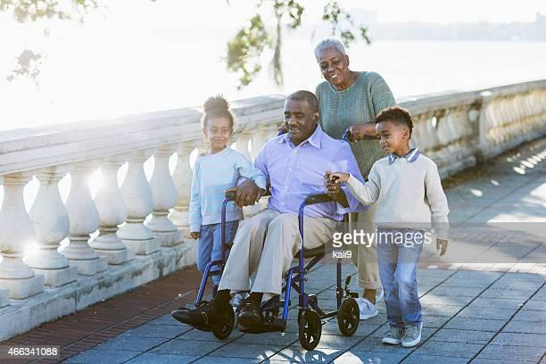 Children taking a walk with their grandparents