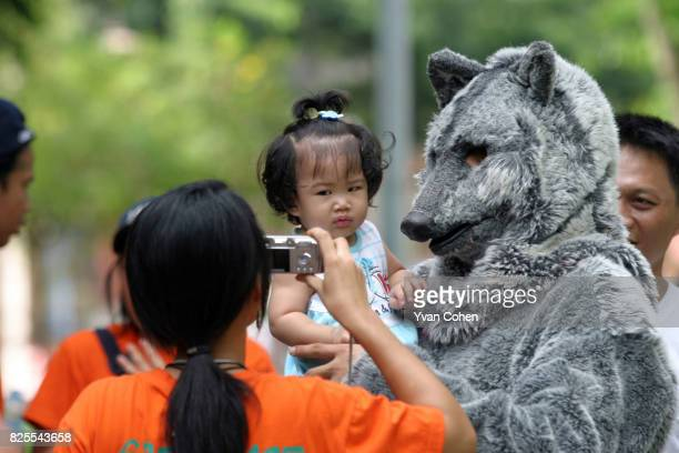 Children taking part in a Kids for the Forests event in Lumpini Park in Bangkok Thailand The event organised by Greenpeace Southeast Asia was part of...