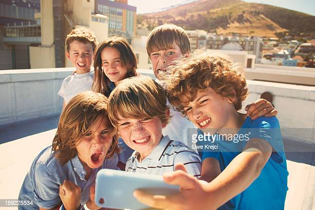 Children taking self-portrait with smart phone