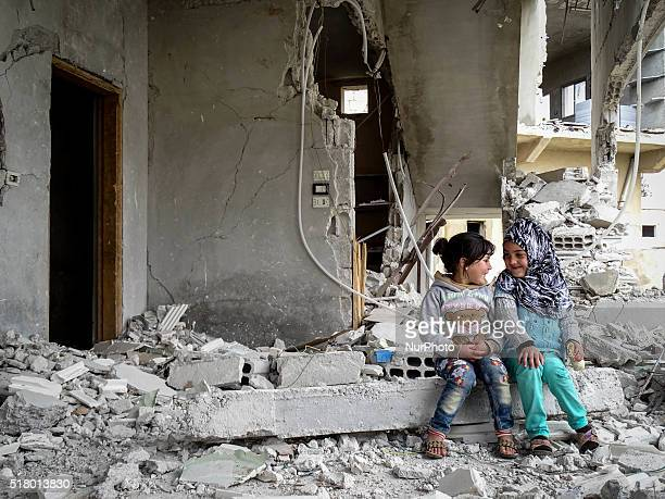 Children talk among the rubble in the city of Daraa Syria on March 29 2016 Daraa it's under rebel control