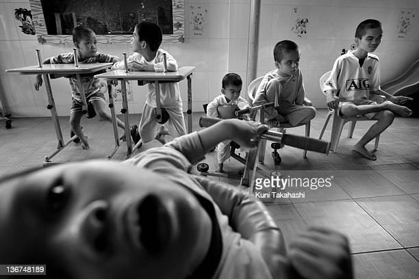 Children that suffer from mental and physical disabilities are seen at the Thien Phuoc Center for Handicapped Children on July 7 2009 in Ho Chi Minh...