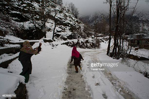 Children throw snow on each other after fresh snowfall on February 2 2015 in Srinagar Indian Administered Kashmir India Several parts of the Kashmir...