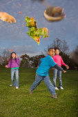 Children (8-10) throwing food