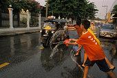 Children Throwing Water During Songkran