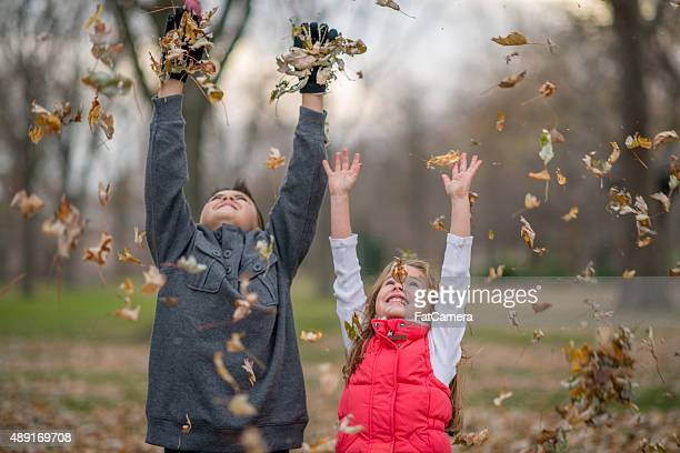 Children Tossing Leaves in the Air