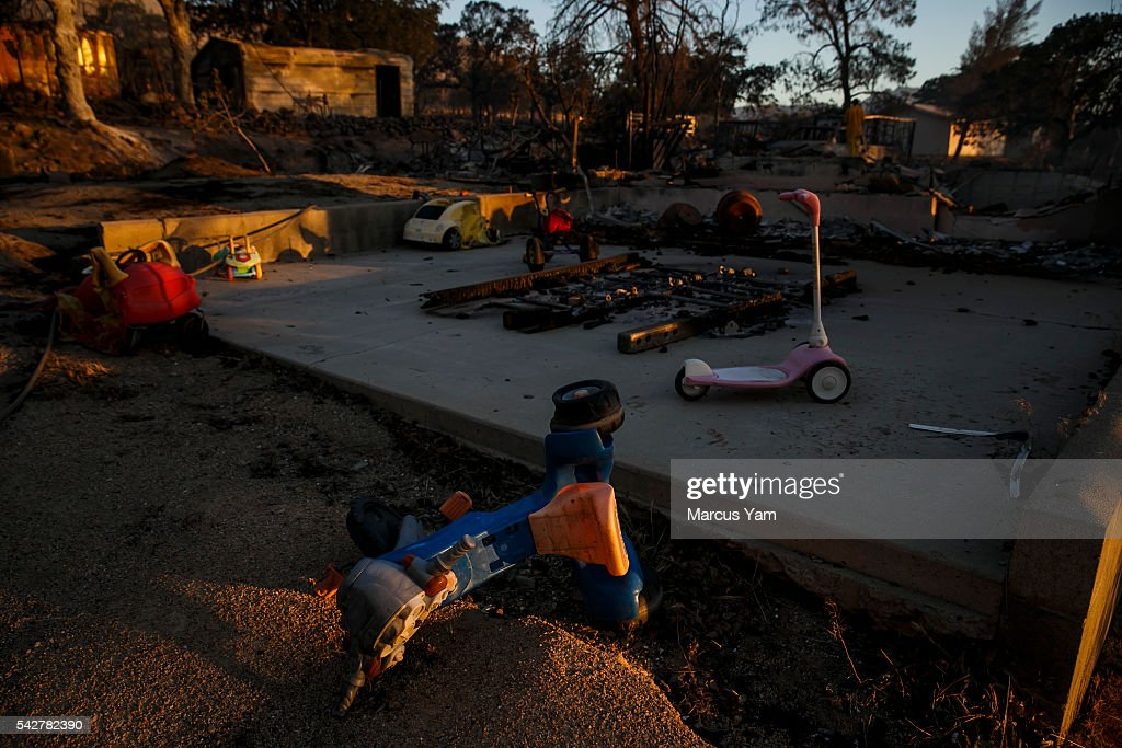 Children toys liter the ground after a home is burned down by wildfire in the Squirrel Mountain Valley, in Lake Isabella, Calif., on June 24, 2016.