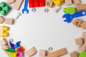 Children toys on white background as frame with copy space for text. Top view. Flat lay