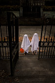 Children Trick or Treat in Ghost Costumes at Haunted House