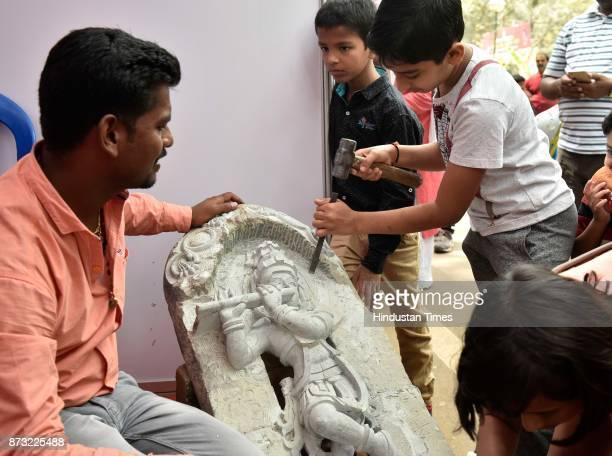 Children trying their hand in sculpting during Makkala Hanna Children Festival at Cubbon Park on November 12 2017 in Bengaluru India Karnataka...