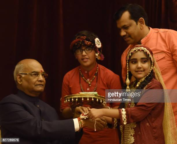 Children tying rakhi to President Ram Nath Kovind and his wife Savita Kovind on the auspicious occasion of Raksha Bandhan at Rashtrapati Bhavan on...