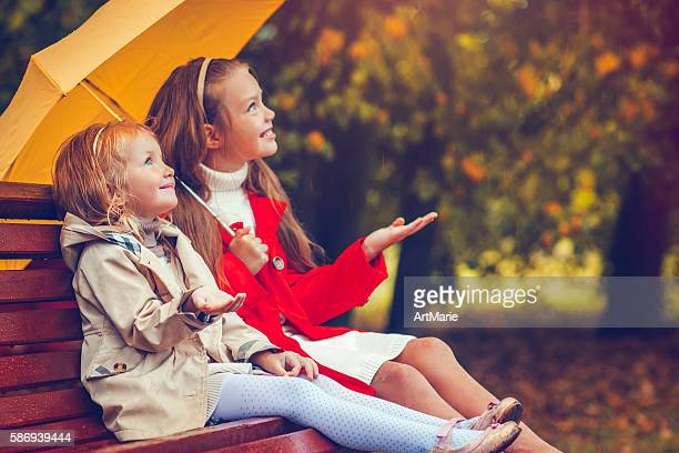 Children under umbrella