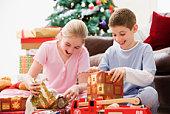 Children unwrapping presents