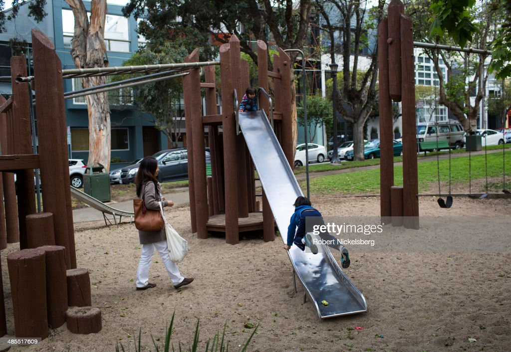 Children use a playground slide April 14, 2014 in the heart of the South Park's start-up district in San Francisco, California. It's rumored that Twitter co-founder Jack Dorsey hatched the idea for Twitter on the children's slide in the park's playground. The area is known as SOMA, or South of Market Street.