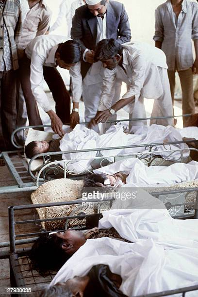 Children victims of the Bhopal tragedy receives first aid from doctors at Bhopal's hospital on December 04 1984 after a poison gas leak from the...