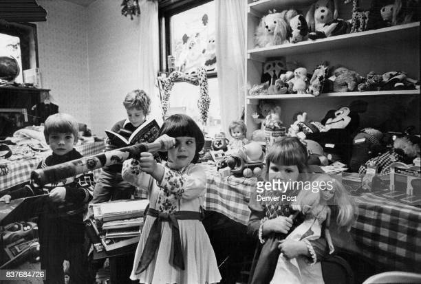 Children Visiting University Thrift Shop Find Lots of Interesting Toys in The Holiday Room From left Toby Dreiling and Scott Feuer like secondhand...