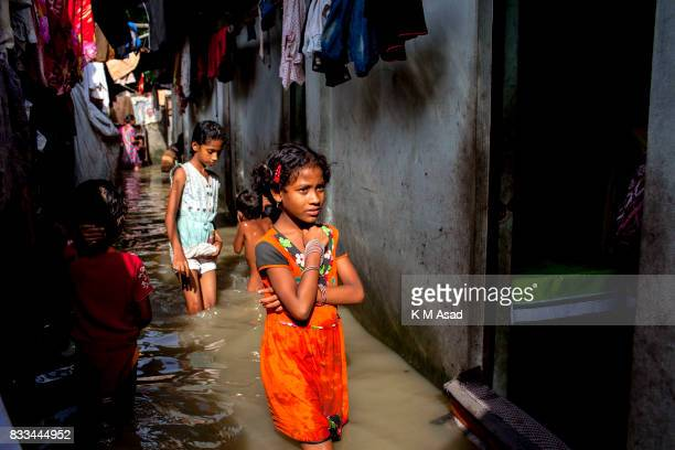 AGRABAD DHAKA CHITTAGONG BANGLADESH Children wading through a flooded area of Chittagong People traveling in flooded areas in Chittagong Chittagong...