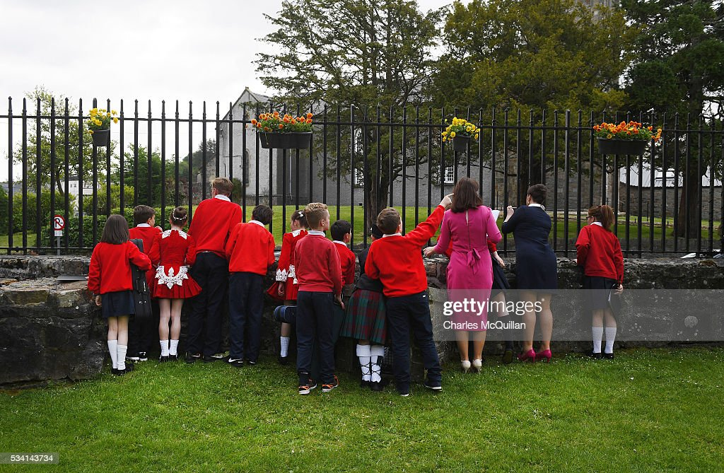 Children wait for a glimpse of Prince Charles, Prince of Wales and Camilla, Duchess of Cornwall as they visit Donegal Castle on May 25, 2016 in Letterkenny, Ireland. The royal couple are on a one day visit to Ireland having spent two days across the border in Northern Ireland. It is their first trip to Donegal.