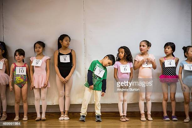 Children wait to audition for the School of American Ballet on April 16 2015 in New York City The School of American Ballet offered free auditions to...