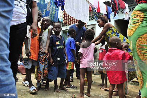 Children wait to receive polio vaccinations on June 25 2011 in the Abobo suburb of Abidjan during the opening of the second national day of polio...