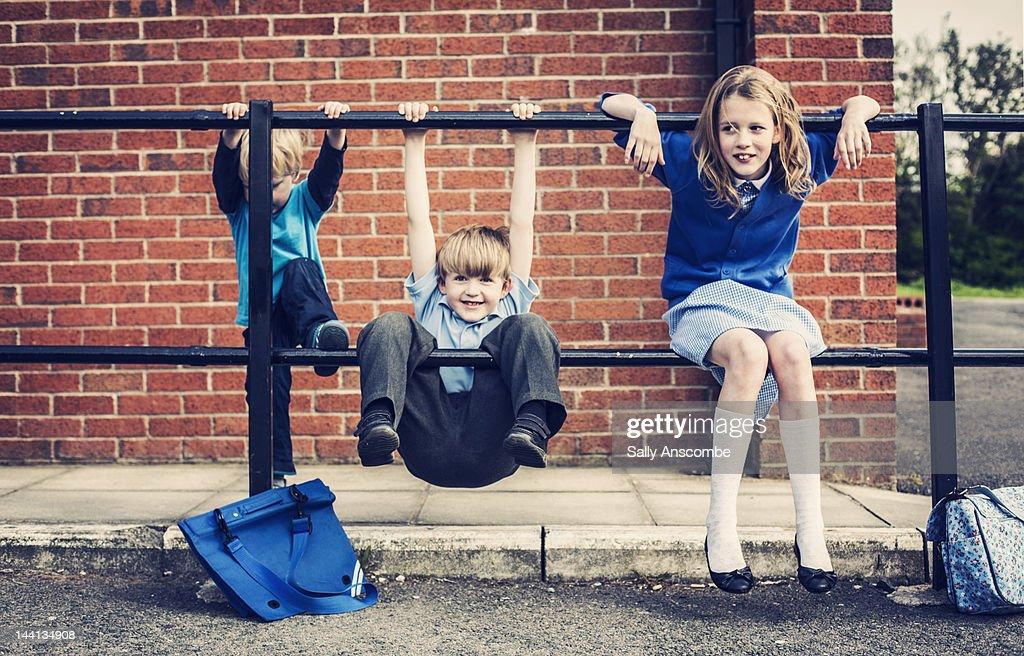 Children waiting outside school : Stock Photo
