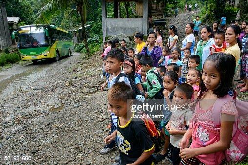 Children waiting to board school transport