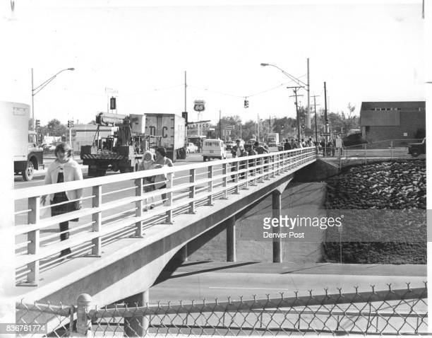 Children Walk Across A Bridge Over 170 Along Pecos St With Sidewalk Only Four Feet Wide Because the children are almost unprotected on both sides...