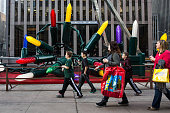 Children walk down Sixth Avenue wearing tshirts thanks to 60 degree weather on December 10 2015 in New York City Temperatures have been unusually...