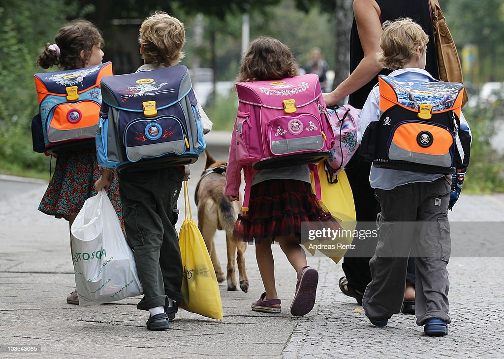 Children walk down the way on the first school day on August 23, 2010 in Berlin, Germany. Many German school districts, including those in Berlin, are reducing the school times pan from 13 to 12 years as part of a nationwide set of primary and secondary school reforms..