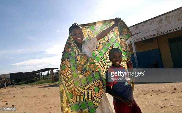 Children walk in the street June 4 2003 in Bunia the provincial capital of Ituri province in Democratic Republic of the Congo The United Nations...