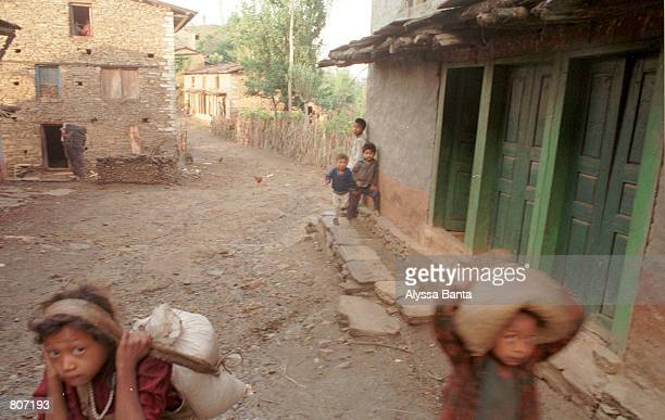 Children walk in the streets April 29 2001 in the Chautara in the Sindupalchowk district of Nepal The Sindupalchowk district is heavily affected by...