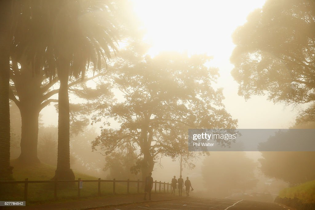Children walk to school as the sun struggles to shine through a blanket of fog over Auckland City on May 4, 2016 in Auckland, New Zealand. The morning fog disrupted flights and ferry services in the city.