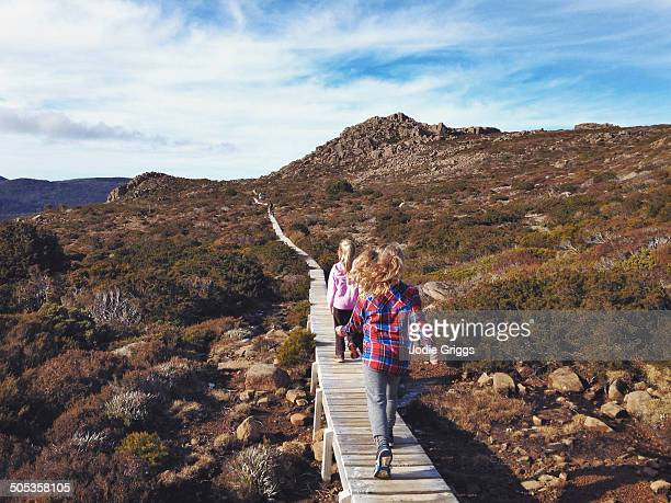 Children walking along a path on mountain top