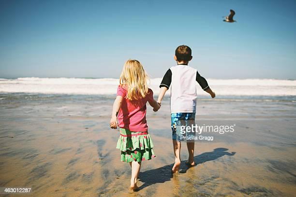 Children walking together on beach