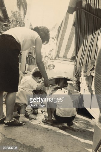 Children washing a vehicle : Stock Photo