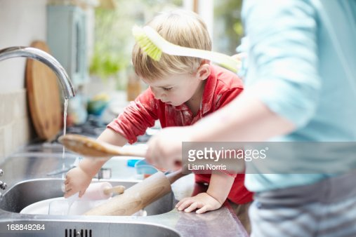 Children washing dishes together