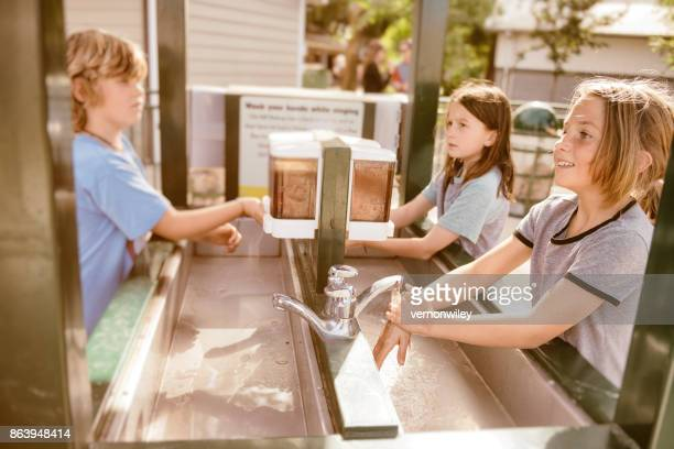 children washing their hands on a field trip