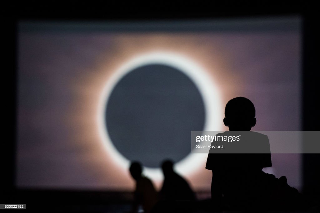 Children watch a presentation about the eclipse during a drive-in movie at the Historic Columbia Speedway August 20, 2017 in Columbia, South Carolina. Columbia is one of the prime destinations for viewing Monday's solar eclipse and NASA expects clear weather would bring over a million visitors to the state.