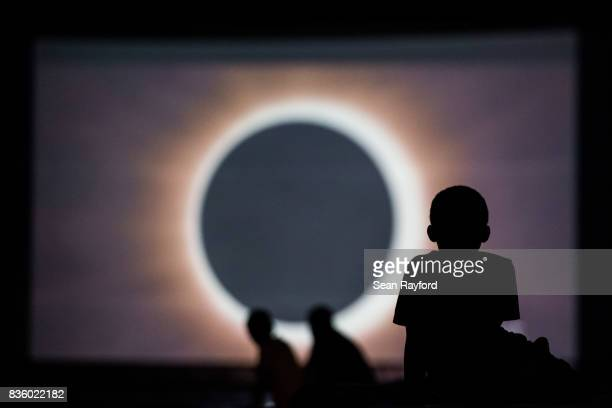 Children watch a presentation about the eclipse during a drivein movie at the Historic Columbia Speedway August 20 2017 in Columbia South Carolina...