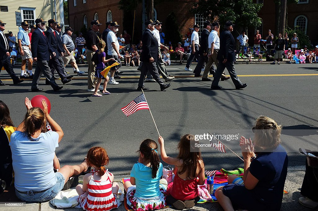 Children watch area veterans in the annual Memorial Day Parade on May 28, 2012 in Fairfield, Connecticut. Across America towns and cities will be celebrating veterans of the United States Armed Forces and the sacrifices they have made. Memorial Day is a federal holiday in America and has been celebrated since the end of the Civil War.