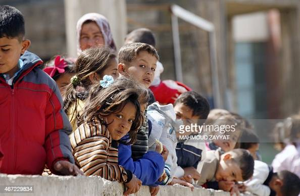 Children watch during a visit of French Junior Minister for Development and FrenchSpeaking Communities minister at a camp housing Syrian refugees who...