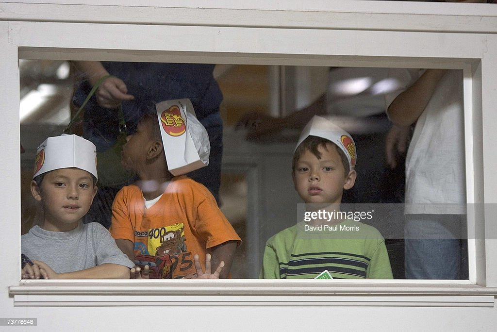 Children watch the assembly line workers at the Jelly Belly Factory April 2, 2007 in Fairfield, California. The Jelly Belly Factory produces approximately 14 billion jelly beans a year. With less than a week before Easter Sunday, retailers stock their shelves full of jelly beans, chocolates, and other traditional candies for Easter.